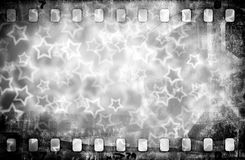 Grunge scratched colorful film strip with stars background. Grunge scratched colorful film strip background with stars Stock Photos