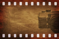 Grunge scratched film with camera. 35mm film textured background grunge style Stock Images