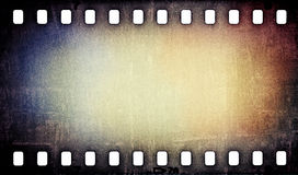 Grunge scratched film strip background. Scratched colorful film strip background Stock Photography