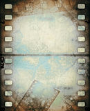 Grunge scratched film strip background. Stock Image