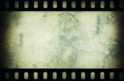 Grunge scratched film strip background. Royalty Free Stock Photo