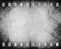 Grunge scratched film strip background. Grunge scratched film strip background with copy space Royalty Free Stock Image