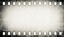 Grunge scratched film strip background Stock Image