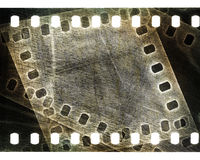 Grunge scratched film strip. Old grunge scratched film strip background Stock Images