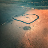 Grunge sea heart symbol Stock Photos