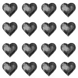 Grunge seamless pattern with hand painted black hearts. Royalty Free Stock Photography