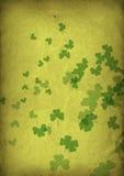 Grunge shamrocks. Fluttering shamrocks in gold and green Stock Photo