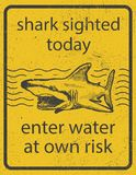 Grunge shark attack warning sign vector eps8 Stock Photos