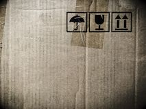 Grunge shipping cardboard box with labels Stock Photography
