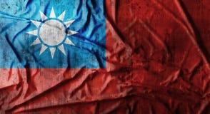 Grunge skrynklade den Taiwan flaggan framförande 3d Royaltyfri Bild