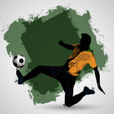 Grunge slide tackle. Soccer player vintage style slide tackling for the ball Stock Photos