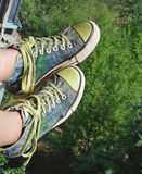Grunge sneakers high. Legs wearing grunge sneakers high Stock Photos