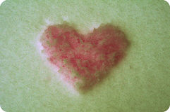 Grunge snow heart Stock Photography