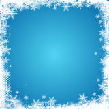 Grunge snowflake border. Grunge style Christmas background with a snowflake border
