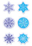 Grunge snowflakes stickers set Stock Images