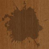 Grunge splash on wooden background Stock Image