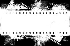 Grunge splashed black and white  film strip frame on black background. Grunge splashed  film strip frame on black background. Retro design element Stock Image