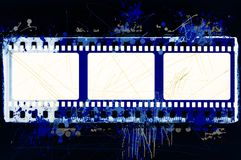 Grunge splashed  film strip frame on black background. With copy space Stock Photography