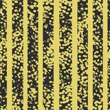 Grunge spotted black and yellow vector seamless pattern. Striped textured background. stock illustration