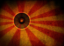 Grunge starburst speaker. Red and yellow grunge starburst speaker Stock Image