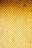 Grunge Steel Background. Yellow and orange steel background/texture with cross hatches Stock Images