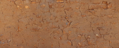 Grunge stone wall covered with clay plaster. Vintage architectur Stock Photo