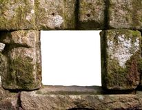 Grunge stone window. Grungy stone window frame with white center cut-out Stock Photography