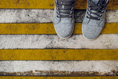 Grunge striped cunstruction background with footwear Stock Photo