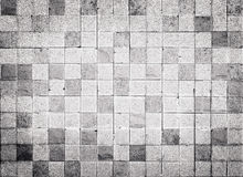Grunge style concrete tile wall texture and background Stock Image