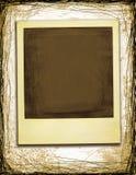 Grunge Style Polaroid. On Worn Background Stock Photos