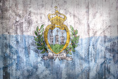 Grunge style of San Marino flag on a brick wall Stock Images