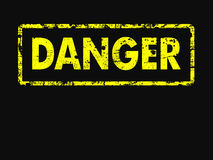 Grunge style yellow and black danger sign Royalty Free Stock Photo