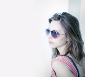 Grunge styled portrait of brunette in sunglasses. Stock Image