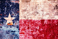 Grunge stylized flag of Texas State. The flag of Texas, painted on the old wall stock photo