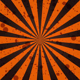 Grunge sunbeam background in Halloween traditional colors. Orange and black sun rays abstract wallpaper. Royalty Free Stock Images