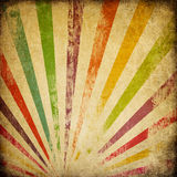 Grunge sunburst colorful background. Stock Photos