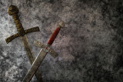Grunge swords fantasy Stock Photography