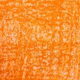 Grunge tło jest barwiącym pomarańczowego wosku małym papierem Obrazy Royalty Free