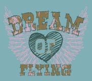 Grunge T-Shirt Design. Illustration of a grunge feminine design for a T-shirt with wings, heart and a caption - Dream of Flying Royalty Free Stock Photos