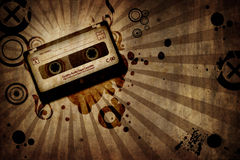 Grunge texture background with music cassete Royalty Free Stock Image