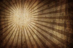 Grunge texture background with sunburst rays. Grunge old paper texture background with radial sunburst rays - landscape orientation Royalty Free Stock Photo