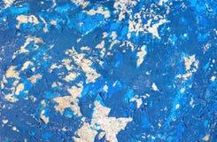 Grunge texture, blue paint peeling from fiberglass surface Stock Images
