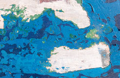 Grunge texture, blue paint peeling from wooden surface Stock Images