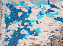 Grunge texture, blue paint peeling from wooden surface Royalty Free Stock Images