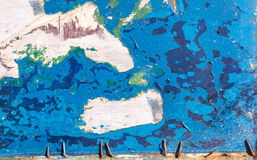 Grunge texture, blue paint peeling from wooden surface Stock Image