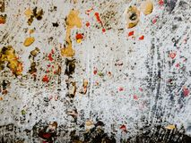Grunge background with red and yellow paint splash. Great grunge texture. Grunge texture with color splash paint on the wall. Useful as grunge backdrop. Horror royalty free stock photos