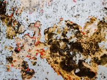 Grunge background with red and yellow paint splash. Great grunge texture. Grunge texture with color splash paint on the wall. Useful as grunge backdrop. Horror royalty free stock photo