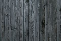 Grunge texture of gray old wooden fence. Gray background of shabby wooden boards, planks. Surface of old shabby weathered wooden p royalty free stock images