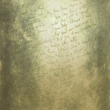 Grunge texture with manuscript. Grunge texture with a letter on a yellow-green scratched background royalty free stock images