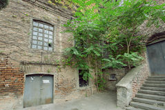 Grunge texture of the old brick house in historical city Tbilisi Royalty Free Stock Photos